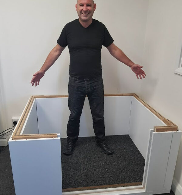 Nik in booth mid-build